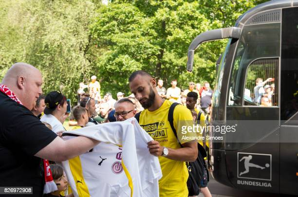 Oemer Toprak of Borussia Dortmund gives autographs prior to the preseason friendly match between RotWeiss Erfurt and Borussia Dortmund at the...