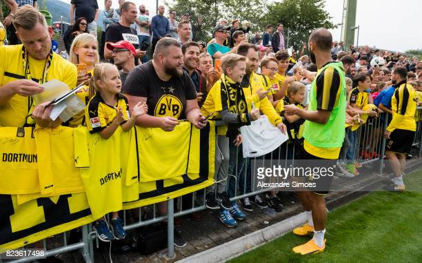 Oemer Toprak of Borussia Dortmund is giving autographs to the fans after a training session as part of the training camp on July 27 2017 in Bad Ragaz...