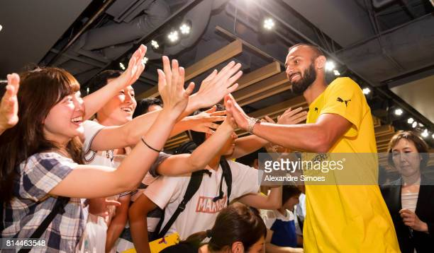 Oemer Toprak of Borussia Dortmund with fans during a meet and greet in the Puma store Harajuku on July 14 2017 in Tokyo Japan