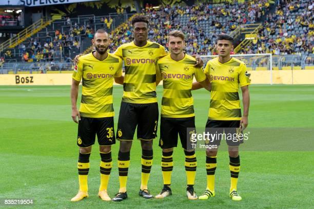 Oemer Toprak of Dortmund DanAxel Zagadou of Dortmund Maximilian Philipp of Dortmund and Mahmound Dahoud of Dortmund looks on during the Borussia...