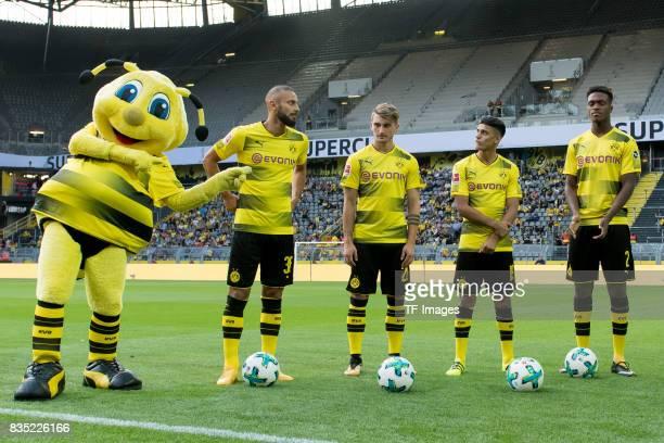 Oemer Toprak of Dortmund Maximilian Philipp of Dortmund Mahmound Dahoud of Dortmund and DanAxel Zagadou of Dortmund looks on during the Borussia...