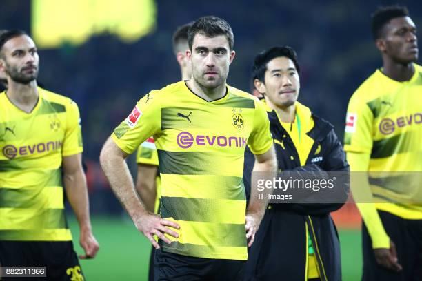 Oemer Toprak of Dortmund Sokratis Papastathopoulos of Dortmund Shinji Kagawa of Dortmund and DanAxel Zagadou of Dortmund looks dejected during the...