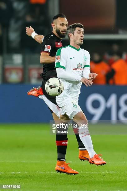 Oemer Toprak of Leverkusen and Fin Bartels of Werder Bremen battle for the ball during the Bundesliga soccer match between Bayer Leverkusen and...
