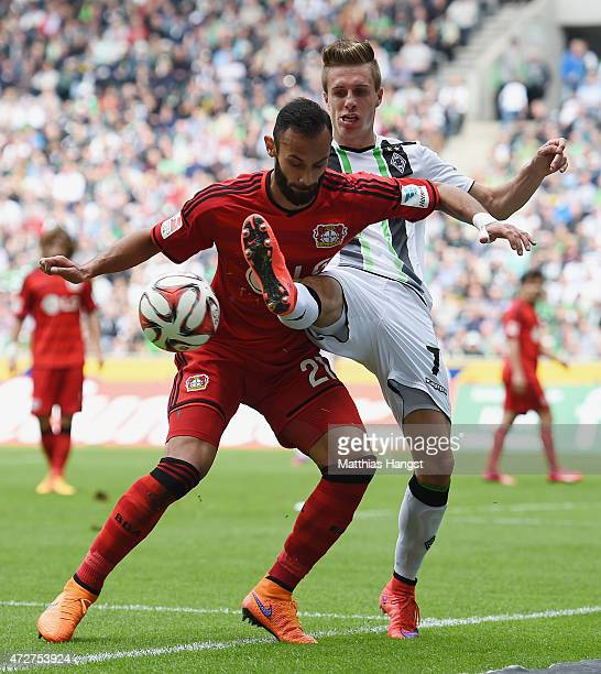 Oemer Toprak of Leverkusen and Patrick Herrmann of Gladbach compete for the ball during the Bundesliga match between Borussia Moenchengladbach and...