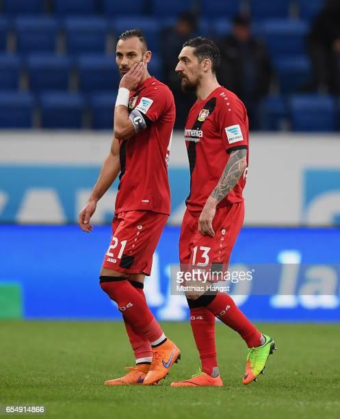 Oemer Toprak of Leverkusen and Roberto Hilbert of Leverkusen show their disappointment during the Bundesliga match between TSG 1899 Hoffenheim and...