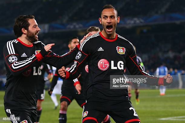 Oemer Toprak of Leverkusen celebrates his team's first goal with team mate Gonzalo Castro during the UEFA Champions League Group A match between Real...