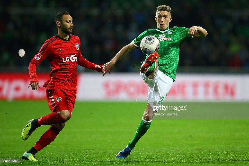 <a gi-track='captionPersonalityLinkClicked' href=/galleries/search?phrase=Oemer+Toprak&family=editorial&specificpeople=5395932 ng-click='$event.stopPropagation()'>Oemer Toprak</a> of Leverkusen challenges <a gi-track='captionPersonalityLinkClicked' href=/galleries/search?phrase=Nils+Petersen&family=editorial&specificpeople=4400792 ng-click='$event.stopPropagation()'>Nils Petersen</a> of Bremen during the Bundesliga match between Werder Bremen and Bayer Leverkusen at Weserstadion on December 21, 2013 in Bremen, Germany.