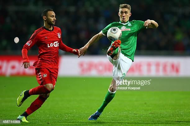 Oemer Toprak of Leverkusen challenges Nils Petersen of Bremen during the Bundesliga match between Werder Bremen and Bayer Leverkusen at Weserstadion...