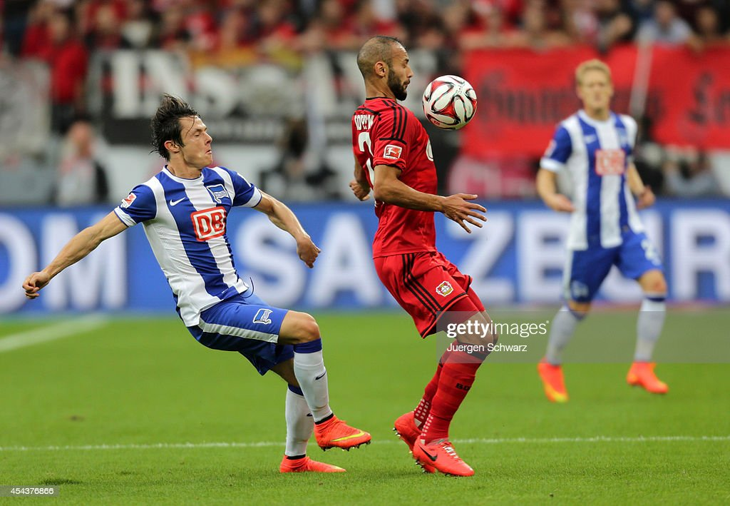 <a gi-track='captionPersonalityLinkClicked' href=/galleries/search?phrase=Oemer+Toprak&family=editorial&specificpeople=5395932 ng-click='$event.stopPropagation()'>Oemer Toprak</a> of Leverkusen (R) controls the ball beside <a gi-track='captionPersonalityLinkClicked' href=/galleries/search?phrase=Nico+Schulz&family=editorial&specificpeople=5385067 ng-click='$event.stopPropagation()'>Nico Schulz</a> of Berlin during the Bundesliga match between Bayer Leverkusen and Hertha BSC Berlin at BayArena on August 30, 2014 in Leverkusen, Germany.