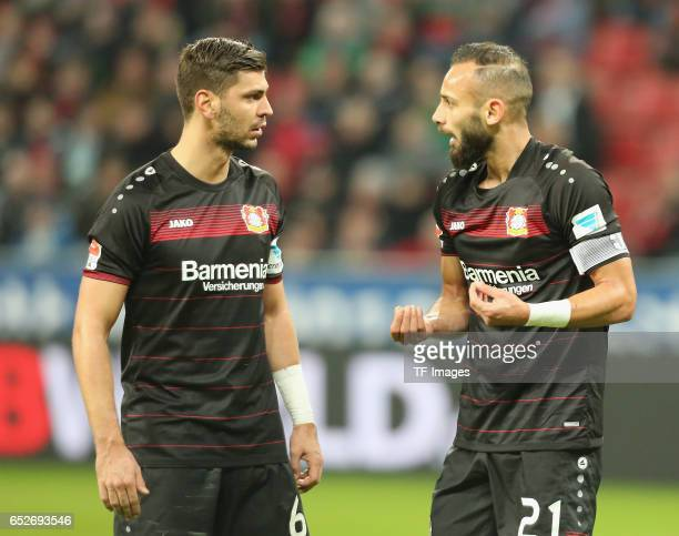Oemer Toprak of Leverkusen speak with Aleksandar Dragovic during the Bundesliga soccer match between Bayer Leverkusen and Werder Bremen at the...