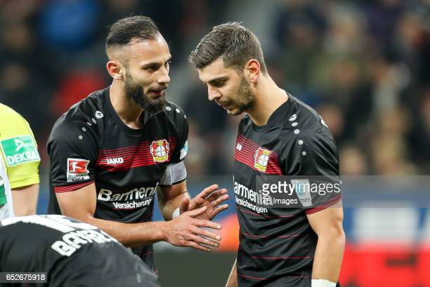 Oemer Toprak of Leverkusen speak with Aleksandar Dragovic of Leverkusen during the Bundesliga soccer match between Bayer Leverkusen and Werder Bremen...