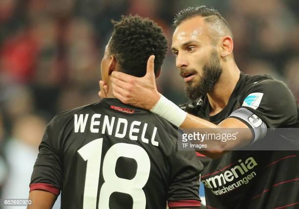 Oemer Toprak of Leverkusen speak with Wendell during the Bundesliga soccer match between Bayer Leverkusen and Werder Bremen at the BayArena stadium...