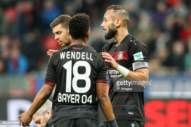 Oemer Toprak of Leverkusen speak with Wendell of Leverkusen during the Bundesliga soccer match between Bayer Leverkusen and Werder Bremen at the...