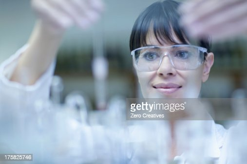 Oenologist mixing during sample testing in laboratory