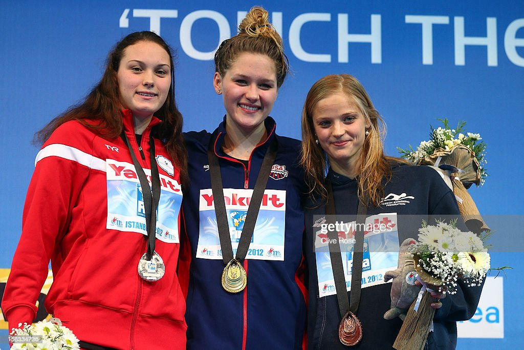Oestergaard Mie Nielsen of Denmark, Olivia Smoliga of USA and Simona Baumrtova of Czech Republic pose with her their medals on the podium after the Women's 100m Backstroke Final during day two of the 11th FINA Short Course World Championships at the Sinan Erdem Dome on December 13, 2012 in Istanbul, Turkey.