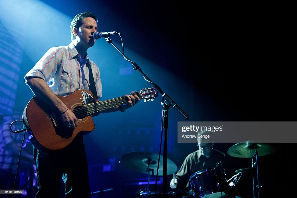 oey Burns and John Convertino of Calexico perform on stage at HMV Ritz on February 16, 2013 in Manchester, England.