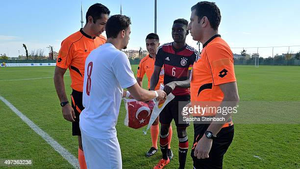 Oezer Oezdemir of Turkey and Idrissa Toure of Germany shake hands prior to the U18 four nations friendly tournament match between Turkey and Germany...