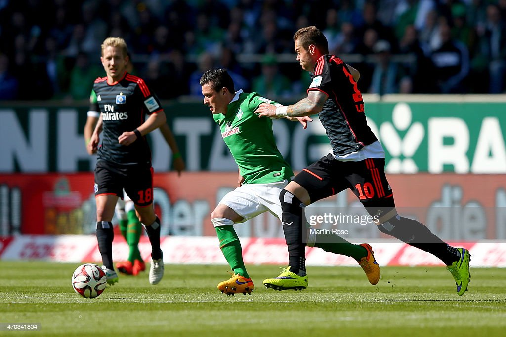 Oezkan Yildirim of Bremen and PierreMichel Lasogga of Hamburg battle for the ball during the Bundesliga match between SV Werder Bremen and Hamburger...