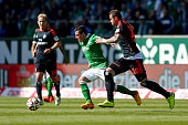 Oezkan Yildirim of Bremen and PierreMichel Lasogga of Hamburg battle for the ball during the Bundesliga match between SV Werder Bremen and Hamburger...