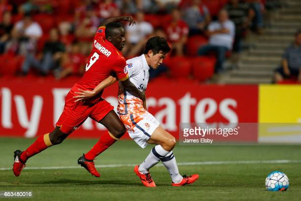 DIAWARA of Adelaide United competes with BAEK DONGGYU of Jeju Unitedduring the AFC Asian Champions League match between Adelaide United and Jeju...