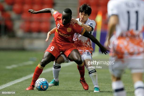 DIAWARA of Adelaide United competes with PARK JIN PO of Jeju United during the AFC Asian Champions League match between Adelaide United and Jeju...