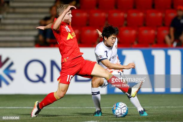 MCGREE of Adelaide United tackles KWON SOONHYUNG of Jeju United during the AFC Asian Champions League match between Adelaide United and Jeju United...