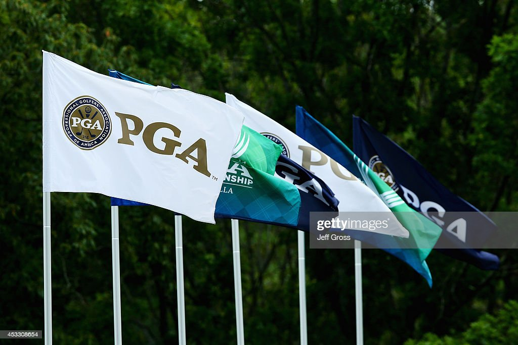 PGA of America flags blow atop a grandstand during the first round of the 96th PGA Championship at Valhalla Golf Club on August 7 2014 in Louisville...