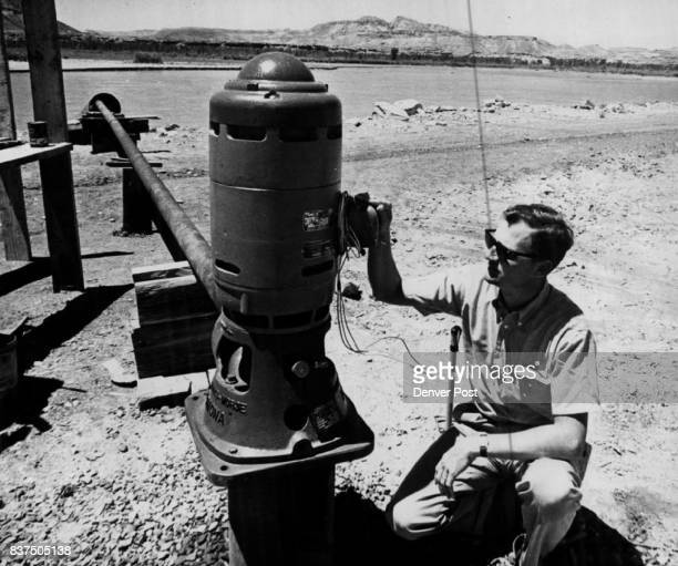 JUL 5 1962 ***** of Aneth Field in Southeastern Utah In picture at the right Emery looks over an electrical pump in installation on the bank of the...