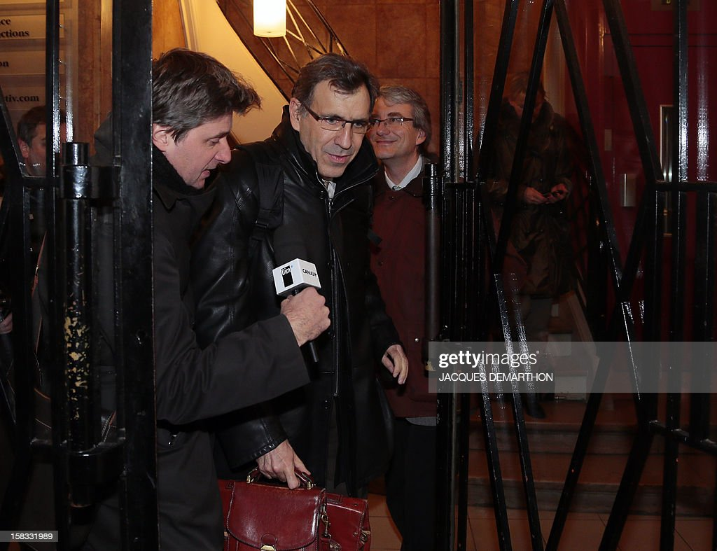 CEO of ArcelorMittal for France Atlantique and Lorraine production centers, Henri-Pierre Orsoni (C) leaves, on December 13, 2012, in Paris, after an extraordinary CCE (Group Central Committee). French President Francois Hollande said last week he would personally guarantee that giant steel multinational ArcelorMittal stood by a commitment to keep jobs at a plant threatened with closure as angry trade unionists threatened strike action. AFP PHOTO/JACQUES DEMARTHON