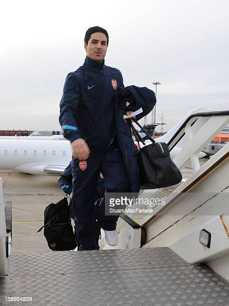 of Arsenal at Luton Airport boards the plane as they travel to Milan ahead of their UEFA Champions League Group match against AC Milan at San Siro...