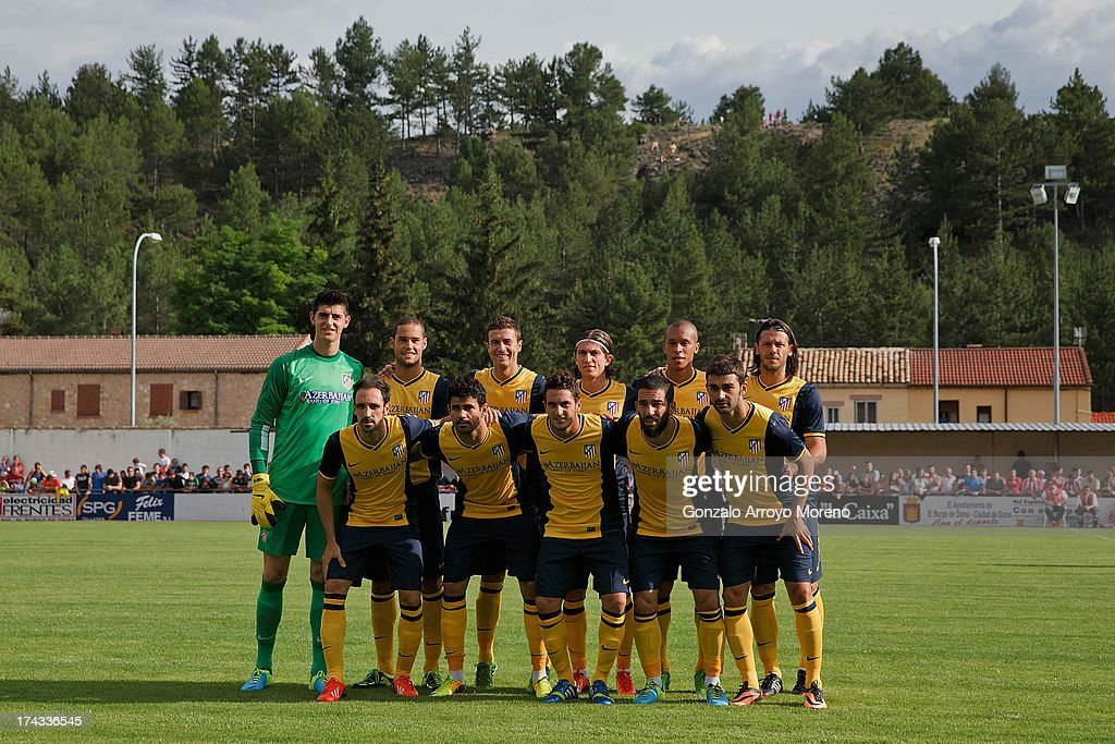 of Atletico de Madrid line up prior to start the Jesus Gil y Gil Trophy between Club Atletico de Madrid and Numancia C. D. at Sporting Club Uxama on July 21, 2013 in Burgo de Osma, Soria, Spain.