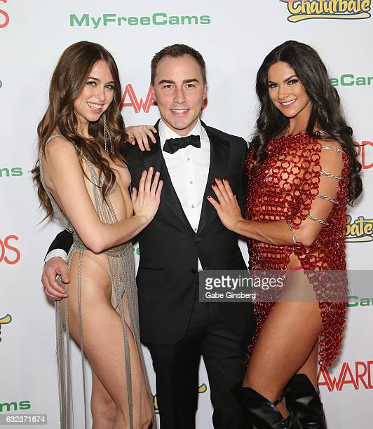 CEO of AVN Media Network Tony Rios flanked by cohosts of the 2017 Adult Video Awards adult film actresses Riley Reid and Aspen Rae attend the 2017...