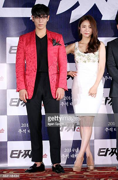 P of BigBang and Shin SeGyeong attend the movie 'Tazza The High Rollers 2' press conference at Geondae Lotte cinema on July 29 2014 in Seoul South...