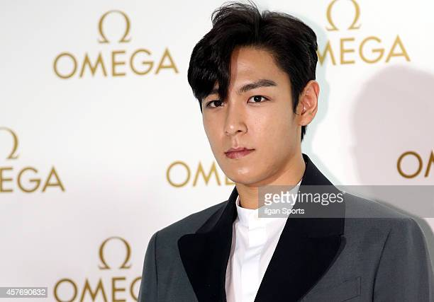 P of BigBang poses for photographs during the OMEGA 'De Ville Prestige Butterfly' launching event at DDP on October 2 2014 in Seoul South Korea