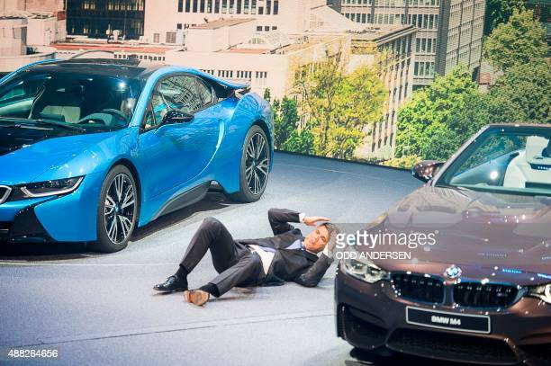 CEO of BMW Harald Krueger falls to the ground after fainting during a presentation at the 66th IAA auto show in Frankfurt on September 15 2015...