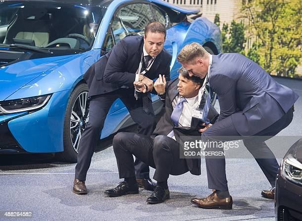 CEO of BMW Harald Krueger is assisted after fainting during a presentation at the 66th IAA auto show in Frankfurt on September 15 2015 Hundreds of...