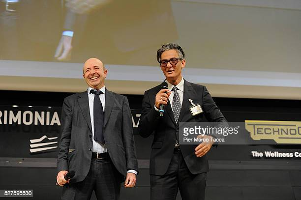 CEO of Borsa Italiana Raffaele Jerusalmi and Rosario Fiorello talk during the Technogym Listing Ceremony at Palazzo Mezzanotte on May 3 2016 in Milan...