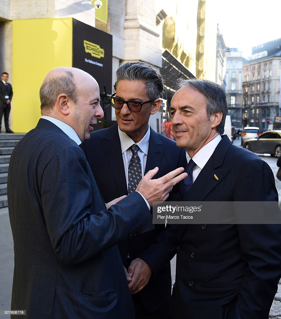 CEO of Borsa Italiana Raffaele Jerusalmi, Rosario Fiorello and Nerio Alessandri attend the Technogym Listing Ceremony at Palazzo Mezzanotte on May 3, 2016 in Milan, Italy. Technogym is the world leader in the construction of equipment for gyms, founded in 1983 by Nerio Alessandri, and was listed today on the Milan Stock Exchange.