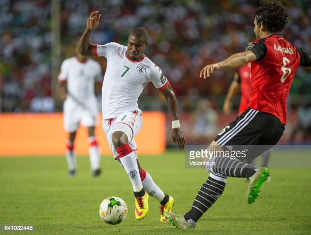 NAKOULMA of Burkina Faso and AHMED ELSAYED ALI ELSAYED HEGAZI of Egypt during the semifinal match between Burkina Faso and Egypt at Stade de L'Amitie...