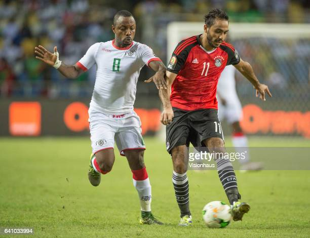 TRAORE of Burkina Faso and MAHMOUD ABDELMONEM ABDELHAMID SOLIMAN of Egypt during the semifinal match between Burkina Faso and Egypt at Stade de...