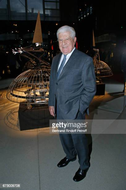 CEO of Cacharel Jean Bousquet pose in front the works of JeanPaul Goude during the 'Societe des Amis du Musee d'Art Moderne du Centre Pompidou'...