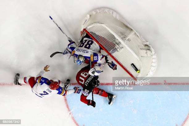 of Canada challenges of Russia for the puck during the 2017 IIHF Ice Hockey World Championship semi final game between Canada and Russia at Lanxess...