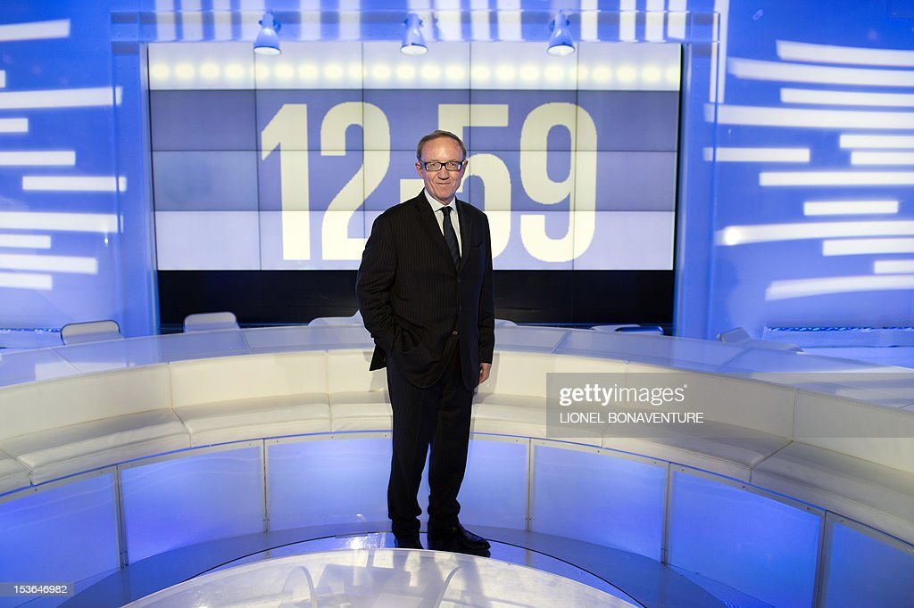 CEO of Canal+, Bertrand Meheut poses during the official launching of the French D8 TV channel flanked by the hosts of the channel on October 7, 2012 in Paris. D8 is the new name of Direct 8 that Canal + group bought to French Bollore group. Bachelot will host the program 'Le Grand 8' with Hapsatou Sy and journalists Elisabeth Bost, Audrey Pulvar and Laurence Ferrari.