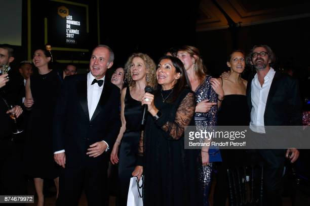 CEO of Condenast France Xavier Romatet listen Awarded as Political Womman of the year Mayor of Paris Anne Hidalgo singing the song of Joe Dassin 'La...