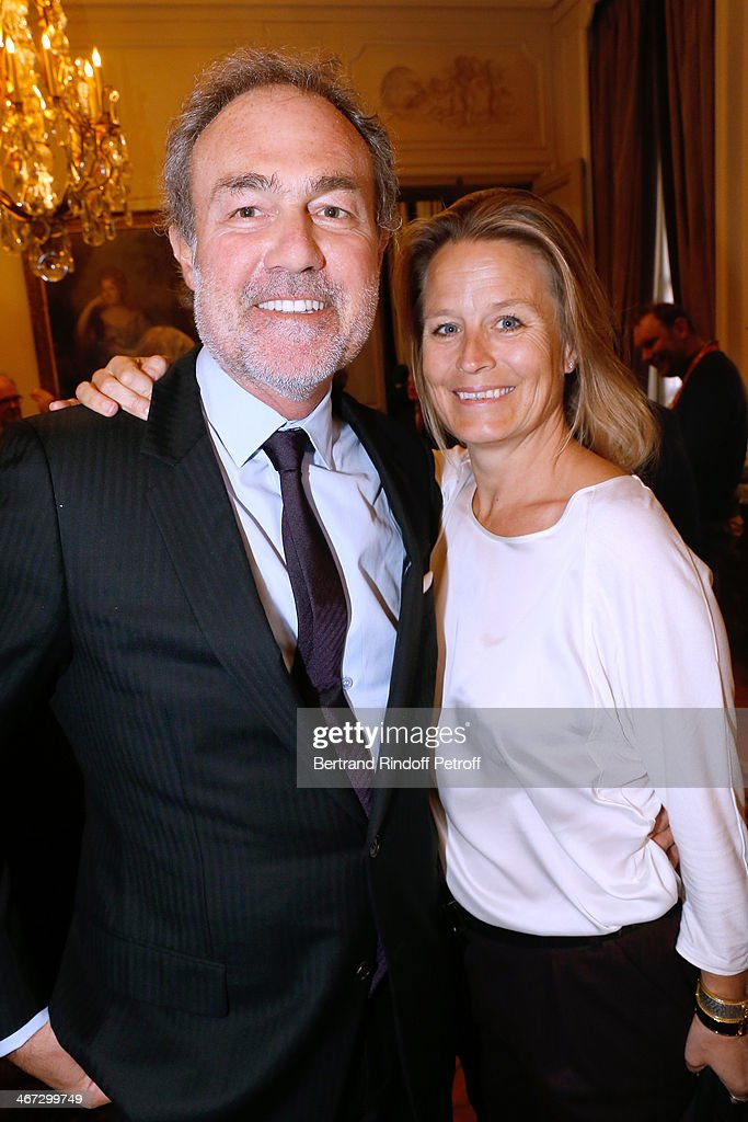 CEO of Crazy Horse Philippe Lhomme with his wife Andree Lhomme attend the King Philippe of Belgium and Queen Mathilde Of Belgium's visit to the Residence of the Ambassador of Belgium during a One Day Official Visit on February 6, 2014 in Paris, France.