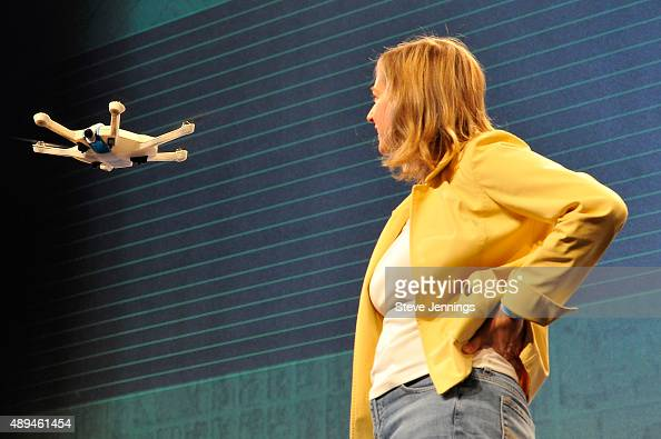 CEO of CyPhy Works Helen Greiner watches as a drone flies onstage during day one of TechCrunch Disrupt SF 2015 at Pier 70 on September 21 2015 in San...