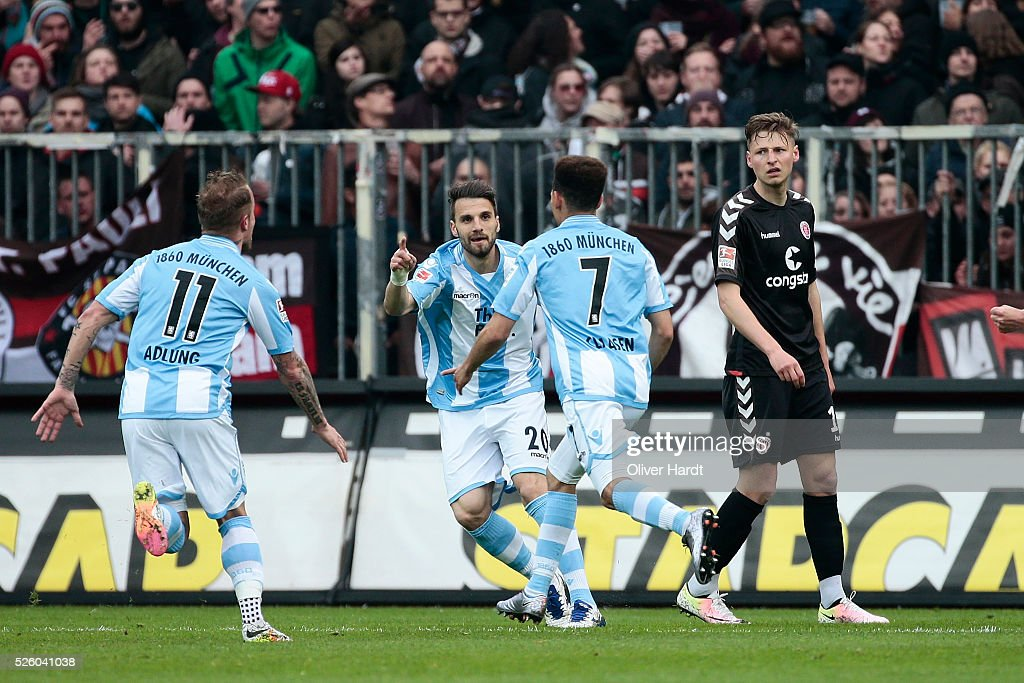 of Dayton Claasen (C) of Muenchen celebrates after scoring their first goal during the Second Bundesliga match between FC St. Pauli and 1860 Muenchen at Millerntor Stadium on April 29, 2016 in Hamburg, Germany.