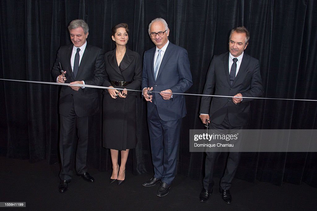 CEO of Dior Sidney Toledano, Marion Cotillard, CEO of the Spring Paolo de Cesare and guest attend the ribon-cutting ceremony to officially launch of the Dior store windows decorated at Printemps Haussmann on November 9, 2012 in Paris, France.