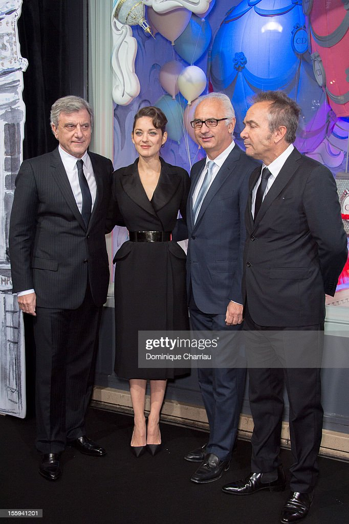 CEO of Dior <a gi-track='captionPersonalityLinkClicked' href=/galleries/search?phrase=Sidney+Toledano&family=editorial&specificpeople=758670 ng-click='$event.stopPropagation()'>Sidney Toledano</a>, <a gi-track='captionPersonalityLinkClicked' href=/galleries/search?phrase=Marion+Cotillard&family=editorial&specificpeople=215303 ng-click='$event.stopPropagation()'>Marion Cotillard</a>, CEO of the Spring Paolo de Cesare and guest attend the launching of the Dior store Christmas windows decorated at Printemps Haussmann on November 9, 2012 in Paris, France.