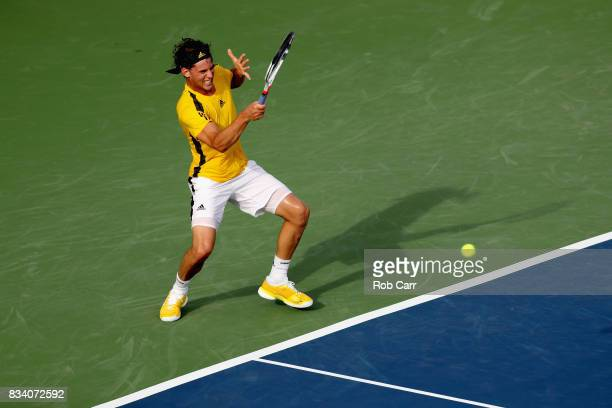 of Dominic Thiem of Austria returns a shot to Adrian Mannarino of France during Day 6 of the Western and Southern Open at the Linder Family Tennis...